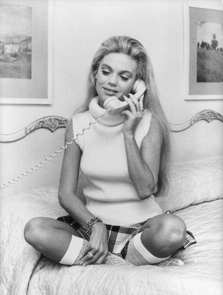 circa 1970:  American actress Dyan Cannon sits cross-legged to make a phonecall.  (Photo by Susan Schiff Faludi/Three Lions/Getty Images)