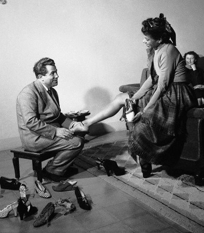 Dance legend Katherine Dunham tries on a few pairs of shoes with the legendary shoe designer, Salvatore Ferragamo, in Florence in 1950. Photo: David Lees/Corbis.