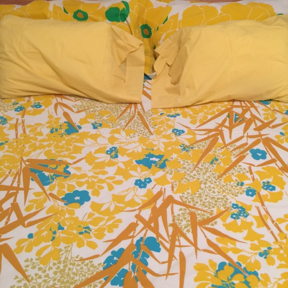 Vintage linens brighten up a bed!